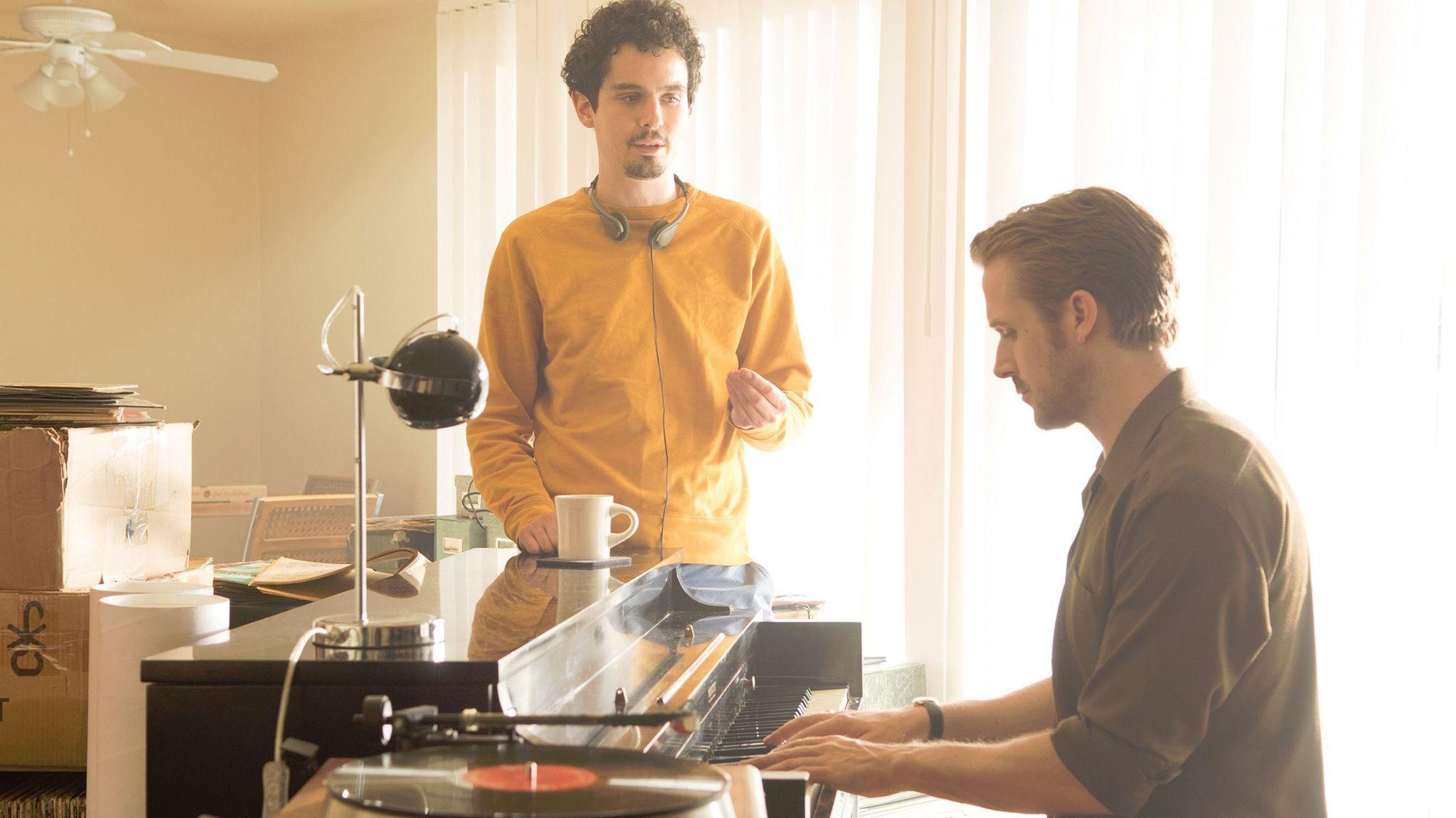 "Director Damien Chazelle and Ryan Gosling on the set of ""La La Land."""