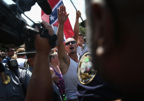 Ku Klux Klan members give the Nazi salute during a demonstration at the state house building on July 18, 2015, in Columbia, S.C. (John Moore / Getty Images)