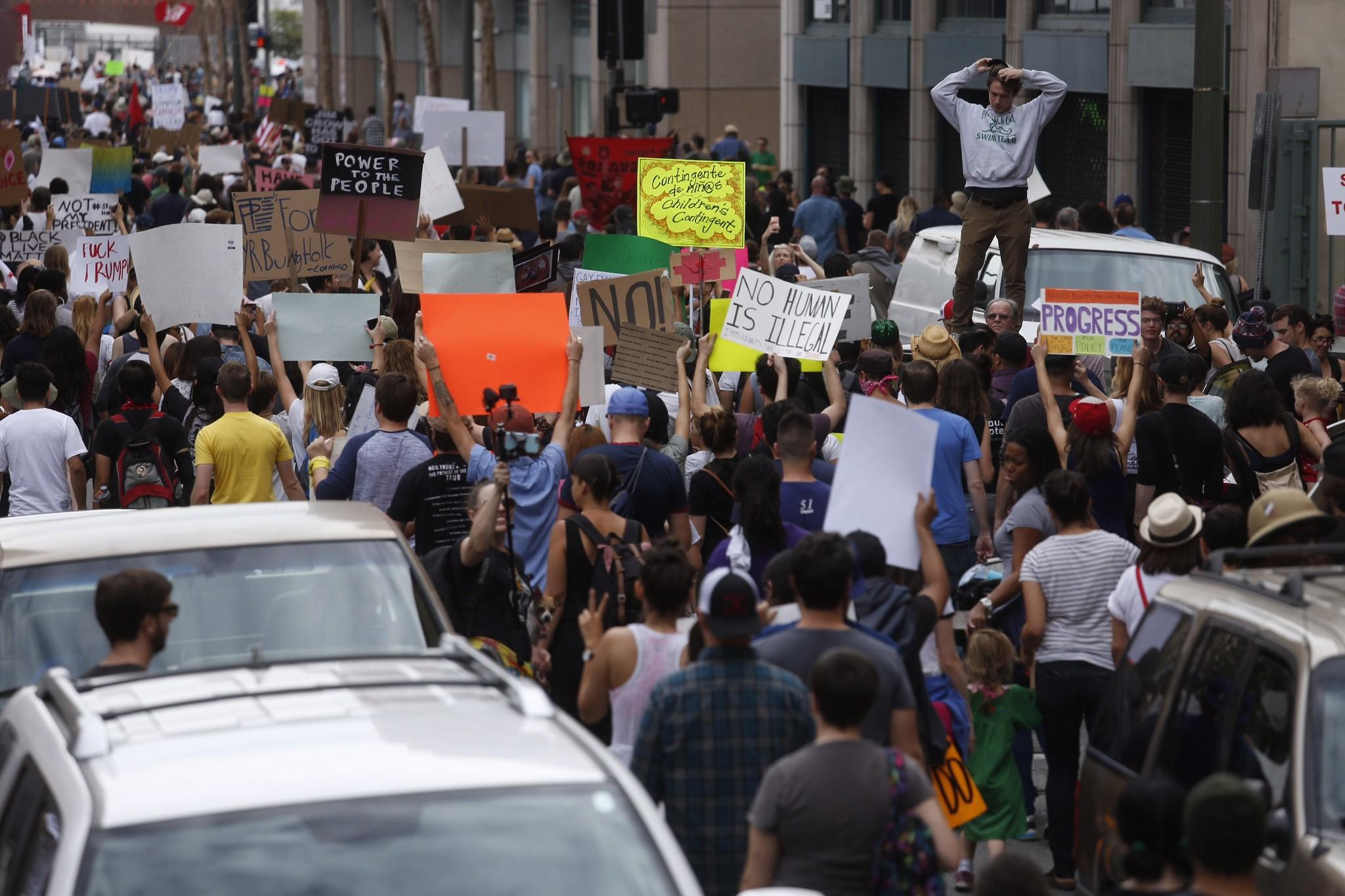 Click the photo for gallery of the march. (Genaro Molina / Los Angeles Times)