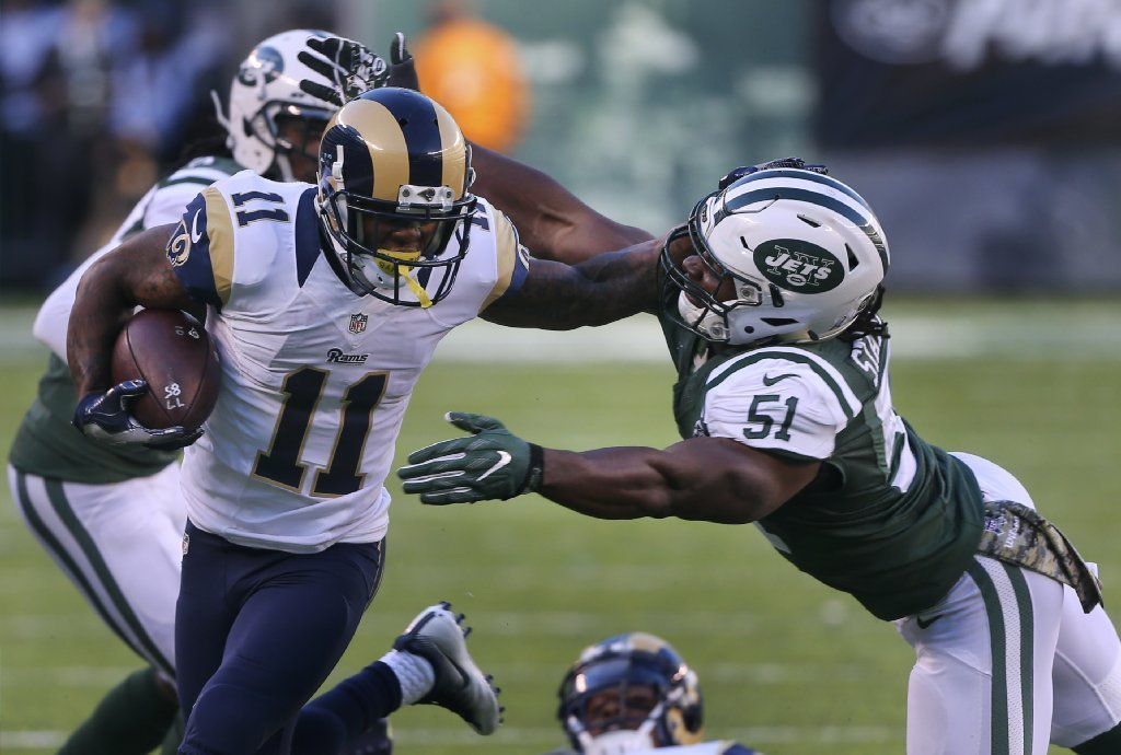 Rams receiver Tavon Austin fends off Jets linebacker Julian Stanford during the third quarter of a game on Sunday. (Seth Wenig / Associated Press)