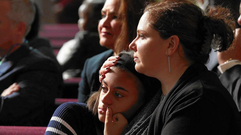 Photo:Jaime Williamson, of Schaumburg, with her daughter Trinity, 14, listen Nov. 13, 2016, to the Rev. Michael Pfleger at St. Sabina Church. (Nancy Stone / Chicago Tribune)