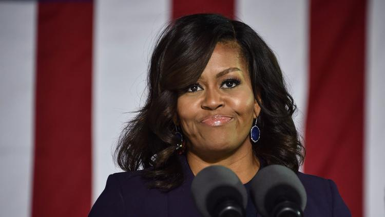 U.S. First Lady Michelle Obama speaks at a rally for Democratic presidential candidate Hillary Clinton in Durham, N.H., on Nov 7. (Nicholas Kamm /AFP/Getty Images)