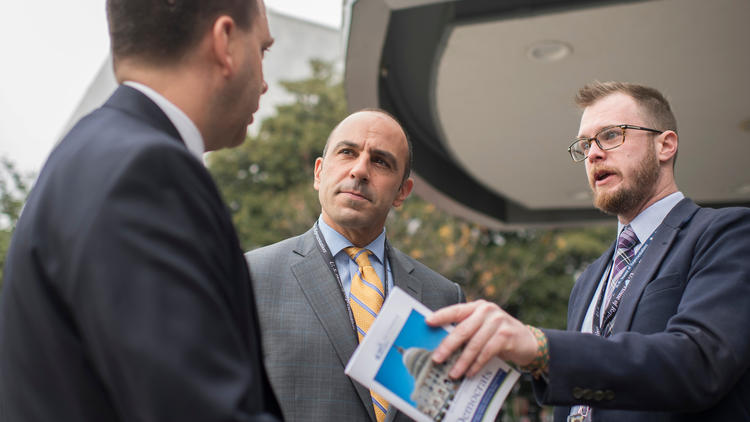 Rep.-elect Jimmy Panetta (D-Carmel), center, is seen outside the Capitol Hill Hotel on Monday, when freshman members of Congress checked in for orientation.