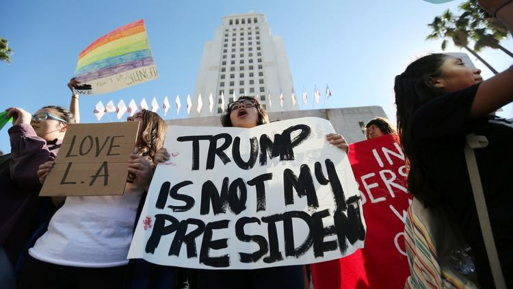 Students from several high schools rally at City Hall in downtown Los Angeles on Nov. 14 after walking out of class to protest the election of Donald Trump. (Reed Saxon / Associated Press)