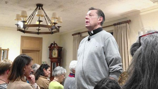 Photo: Father Michael Pfleger ponders a question during a talk he gave Nov. 14 at Kenilworth Union Church. Pfleger, pastor of Chicago's St. Sabina Catholic Church, talked about efforts to reduce gang violence and other interconnected problems to more than 150 listeners. (Kathy Routliffe / Pioneer Press)
