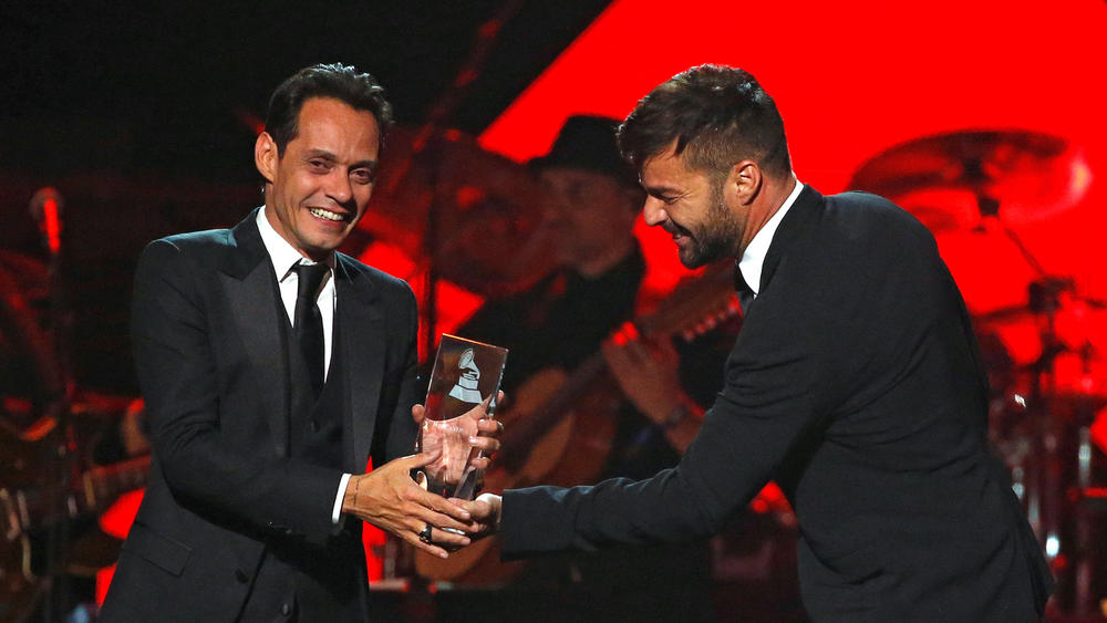 Singer Martin presents recording artist Anthony with the Latin Recording Academy Person of the Year award in Las Vegas