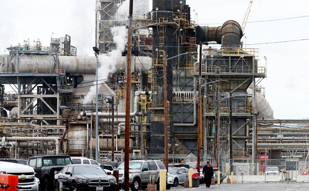 Oil refineries, such as this one in Torrance, could face stricter rules on emissions.