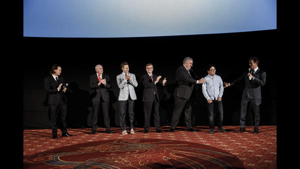 Actor and producer Mark Wahlberg, far left, and director Peter Berg, far right, introduce some of the real people from the 2013 Boston Marathon bombing. (Jay L. Clendenin / Los Angeles Times)