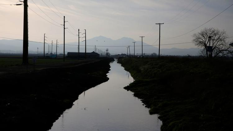 A waterway that connects to the Sacramento-San Joaquin River Delta runs along Route 4, just outside Stockton. (Los Angeles Times)