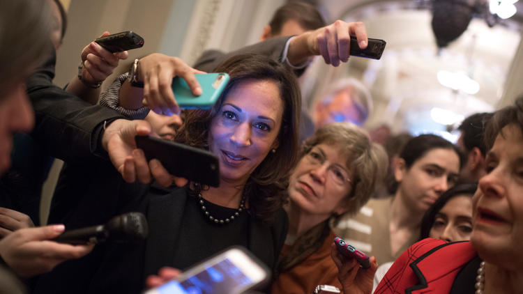 Sen.-elect Kamala Harris (D-Calif.) finds herself surrounded by reporters questioning Sen. Dianne Feinstein.