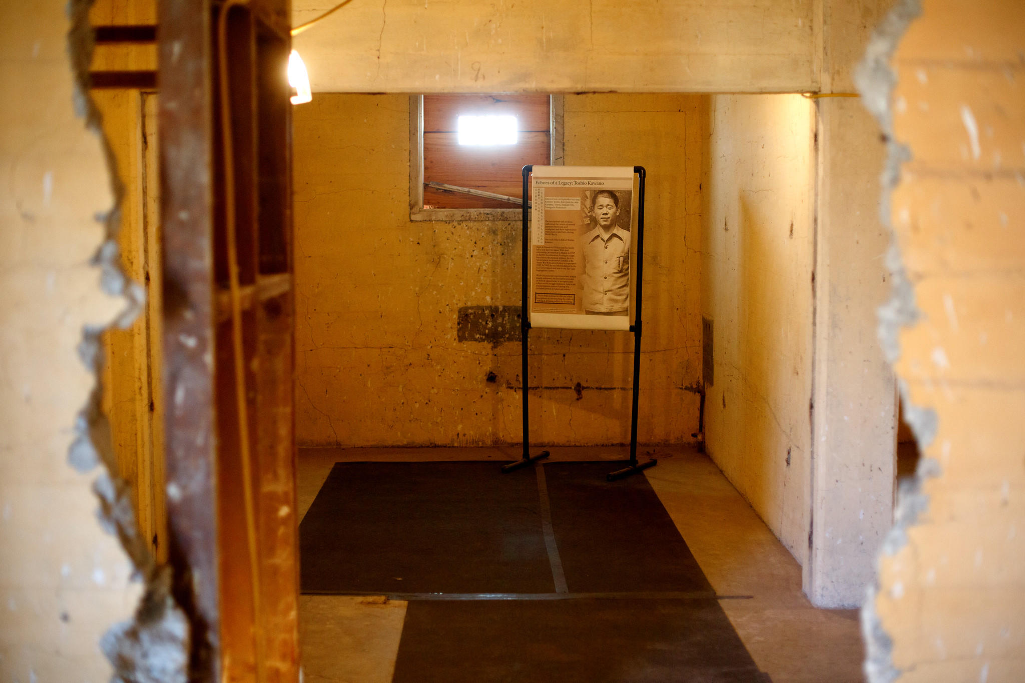 Toshio Kawano is shown in a photograph in the holding cell where he left inscriptions inside the high security jail at the Tule Lake Segregation Center.