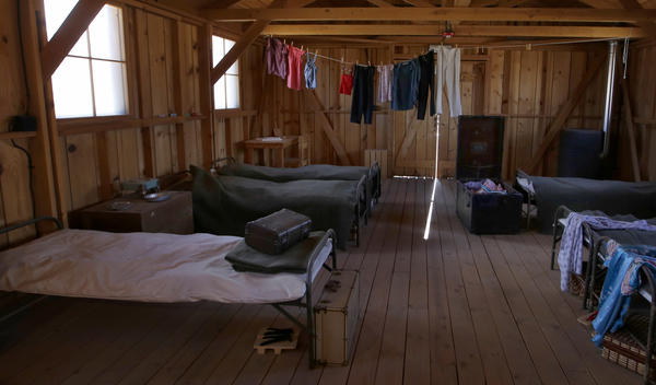 An exhibit of articles inside a replica barracks at Manzanar National Historic Site. (Francine Orr / Los Angeles Times)