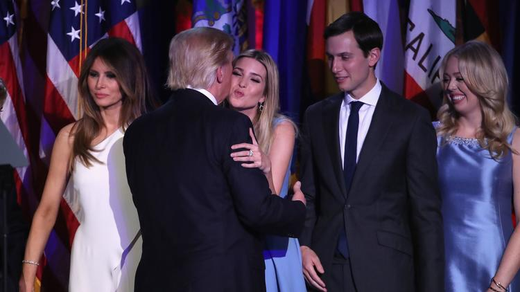 President-elect Donald Trump kisses his daughter Ivanka. Her husband, Jared, right, helped steer the winning campaign.