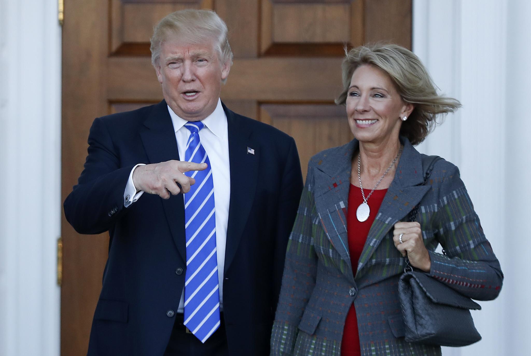 President Trump and Education Secretary Betsy DeVos. (Carolyn Kaster / Associated Press)