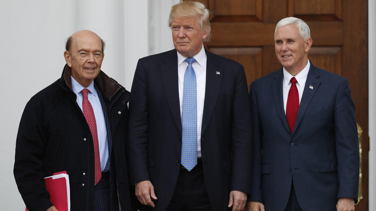 President-elect Donald Trump and Vice President-elect Mike Pence greet investor Wilbur Ross, left, in New Jersey on Sunday. (Carolyn Kaster / Associated Press)