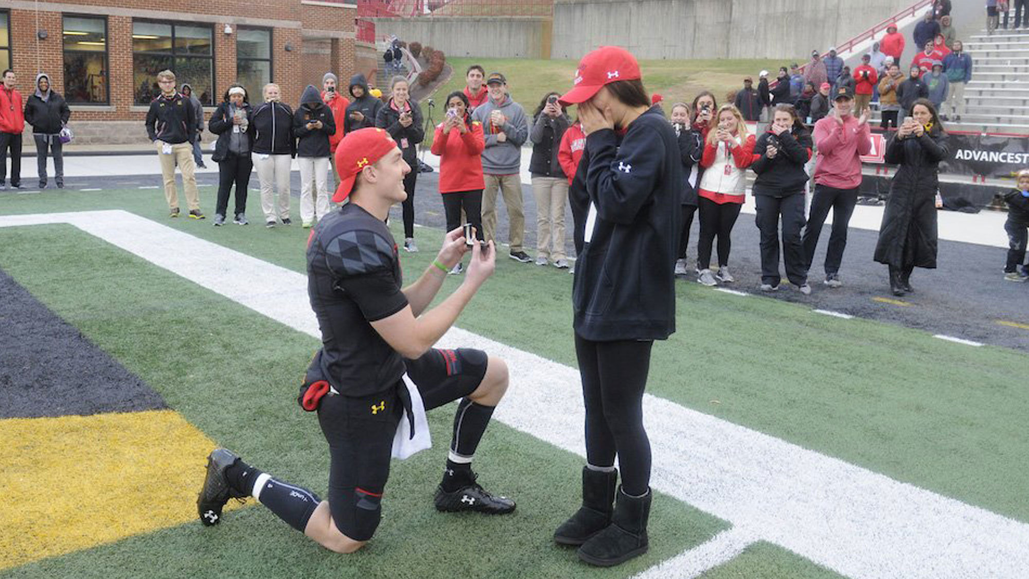 Bal-maryland-quarterback-caleb-rowe-proposes-to-longtime-girlfriend-on-field-after-win-20161126