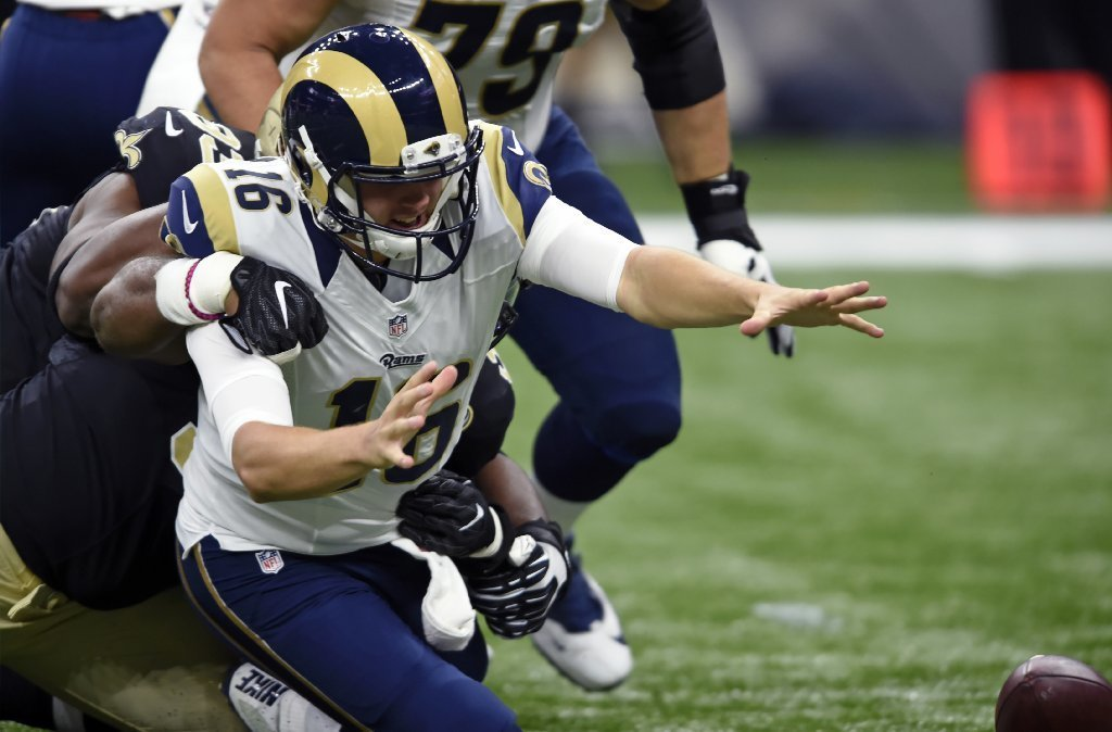 Rams quarterback Jared Goff fumbles during the first half of Sunday's game against New Orleans. (Bill Feig / Associated Press)