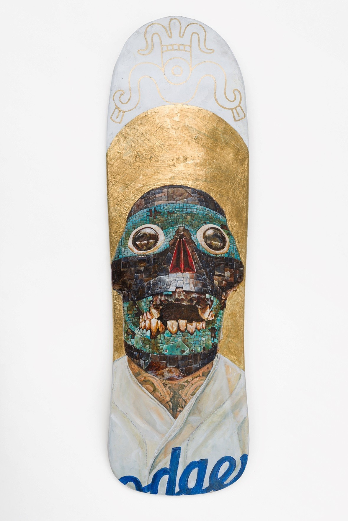 "Ricardo Estrada's ""Tezcatlipoca,"" 2016, acrylic and gold leaf on skateboard, 31-by-9 inches."