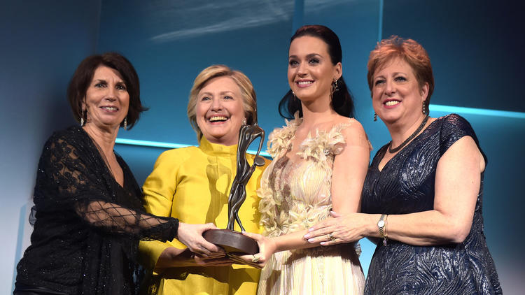 Hillary Clinton and Katy Perry with UNICEF's Pamela Fiori, left, and Caryl Stern, right. (Jason Kempin / Getty Images)