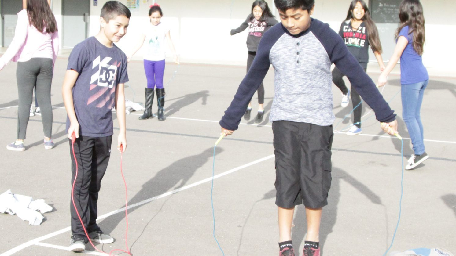 Ramona Elementary sixth-grader Carlos Sanchez watches as classmate Luis Bautista jumps rope.
