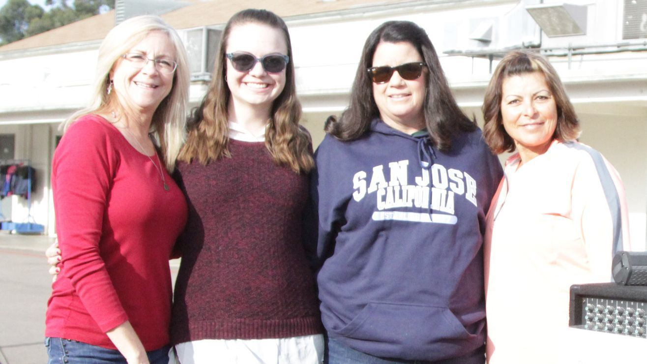 From left, Principal Pixie Sulser, sixth-grade teacher and event chair Katie Lane, Kathleen Diaz and campus supervisor Evelia Torres stand near the announcement table. Kathleen is the wife of the late Andy Diaz, in whose memory the fundraiser was held.
