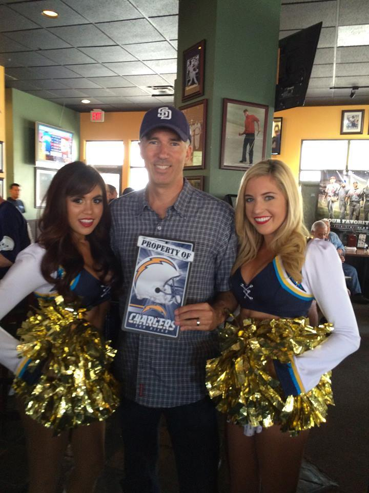 A fan wins a prize at a Oggi's Chargers watch party.