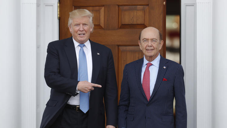 President-elect Donald Trump, left, with investor Wilbur Ross, whose estimated worth is $2.5 billion. (Carolyn Kaster / Associated Press)