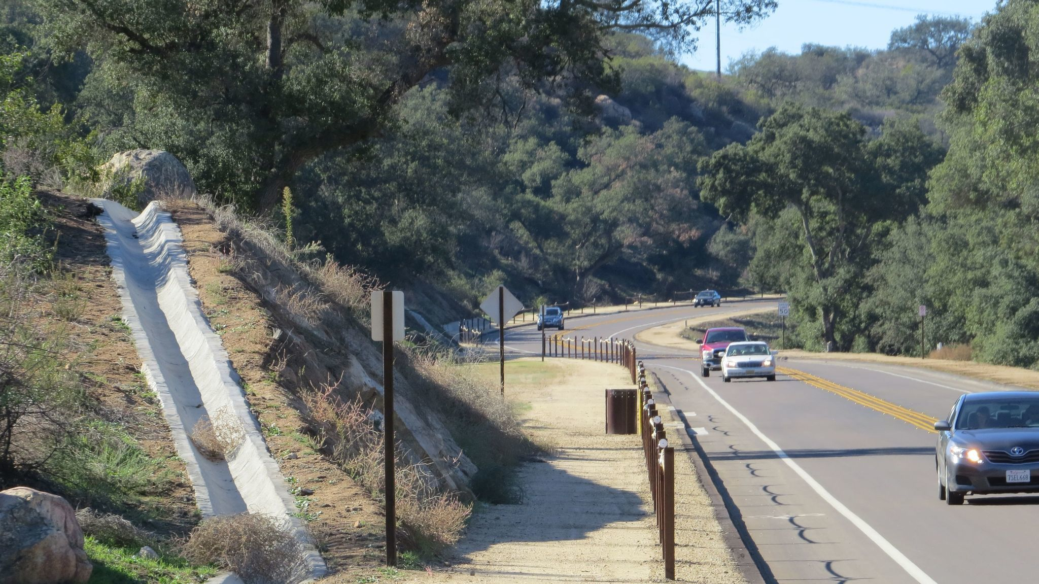 A 10-foot-wide multi-use trail runs along a 2.2-mile section of San Vicente Road in Ramona that has recently been widened and straightened by the county at a cost of $22 million.