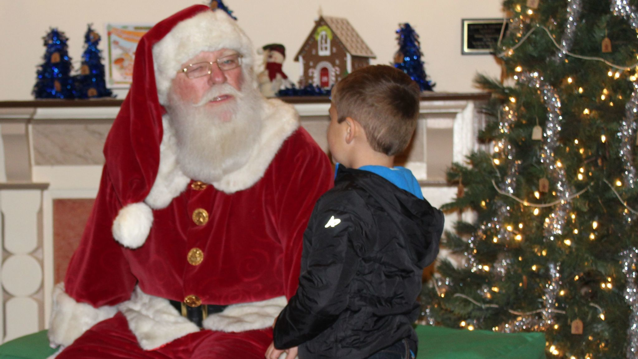 Brayden Whitworth, 5, tells Santa he wants toys lizards for Christmas.