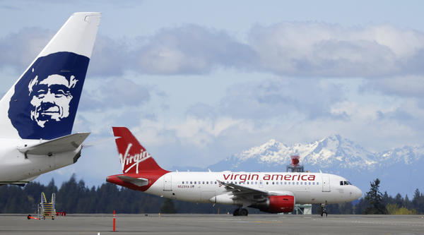Justice Department approves Alaska Airlines' acquisition of Virgin America