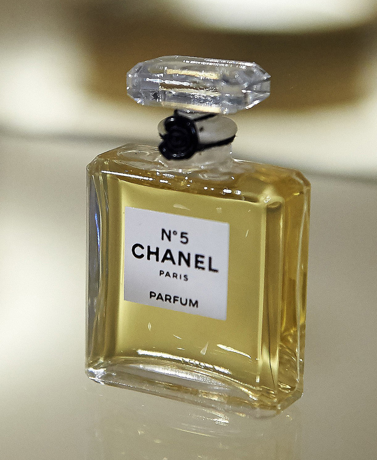 chanel no 5 perfume threatened by train crossing flower. Black Bedroom Furniture Sets. Home Design Ideas