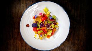 A French chef makes a plate of vegetables into a work of art
