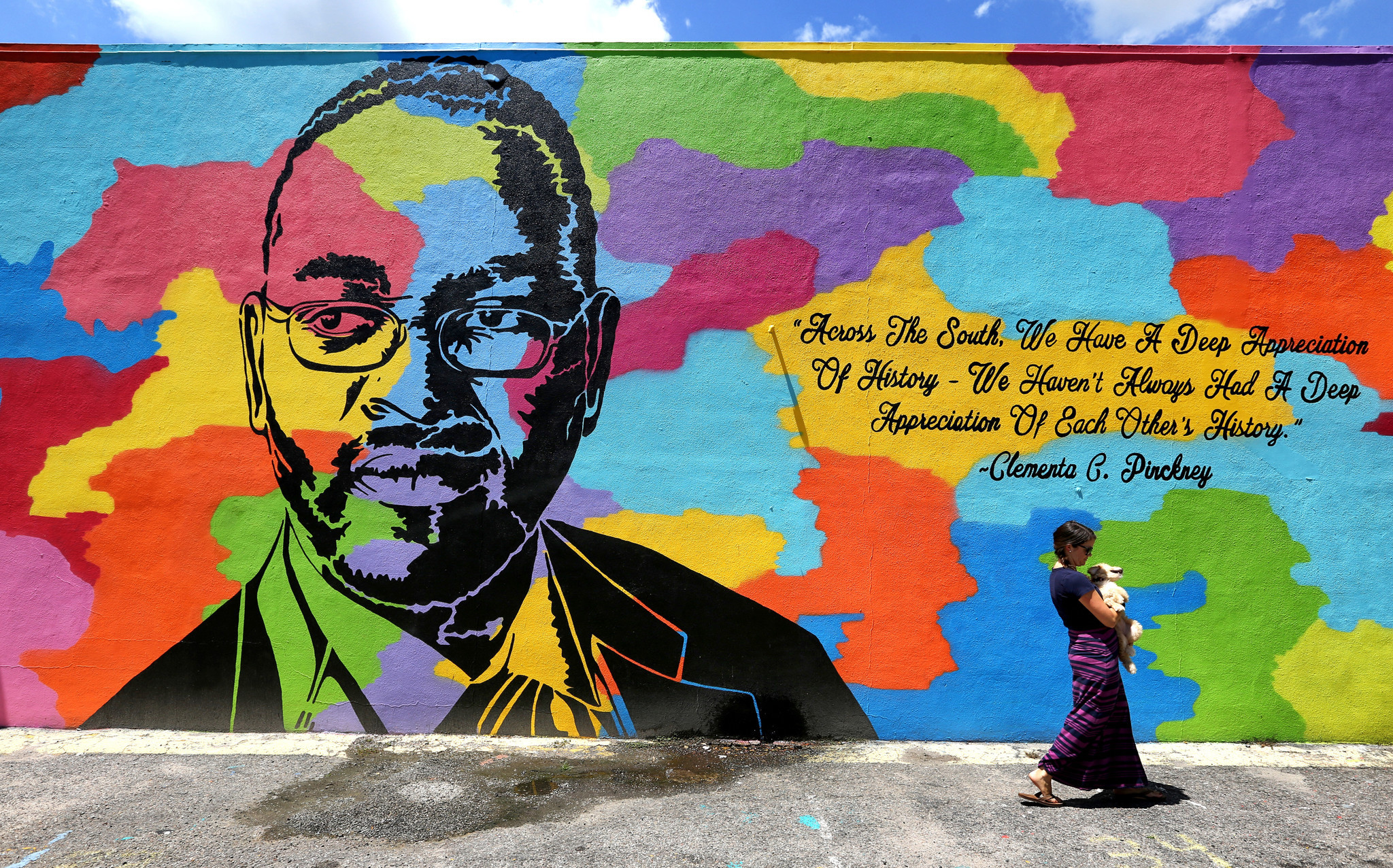 At the Redux Contemporary Art Center, a mural on the exterior memorializes the words of state senator and senior pastor Clementa C. Pinckney, who was killed in the church shooting.
