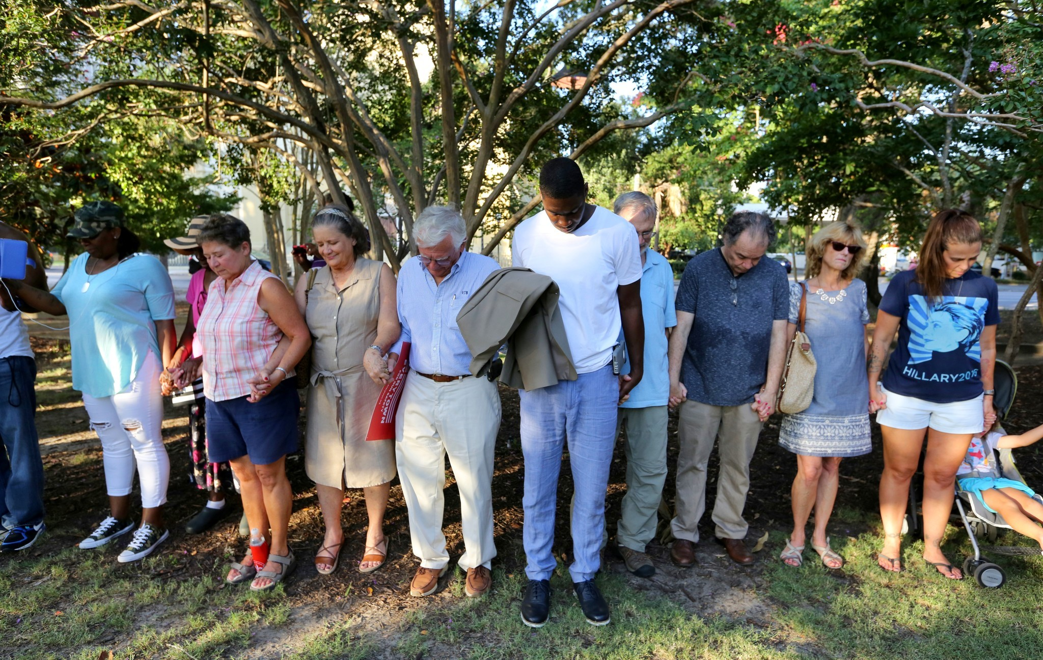Residents pray at an anti-gun violence vigil this past July to honor those killed in the mass shooting at the Emanuel African Methodist Episcopal Church.