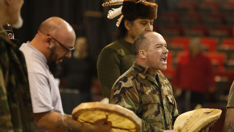 Native American veterans sing before a cleansing ceremony held by tribal members at the Prairie Knights Casino.
