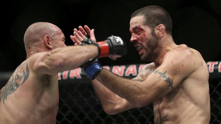 Donald Cerrone, left, battles Matt Brown during their bout at UFC 206 in Toronto. (Peter Power / Associated Press)