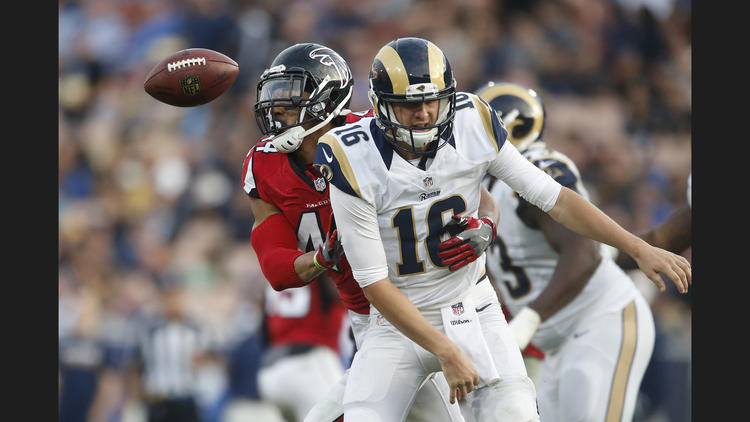 Falcons linebacker Vic Beasley Jr. strips the ball from Rams quarterback Jared Goff. To see more images from the game, click on the photo above. (Robert Gauthier / Los Angeles Times)