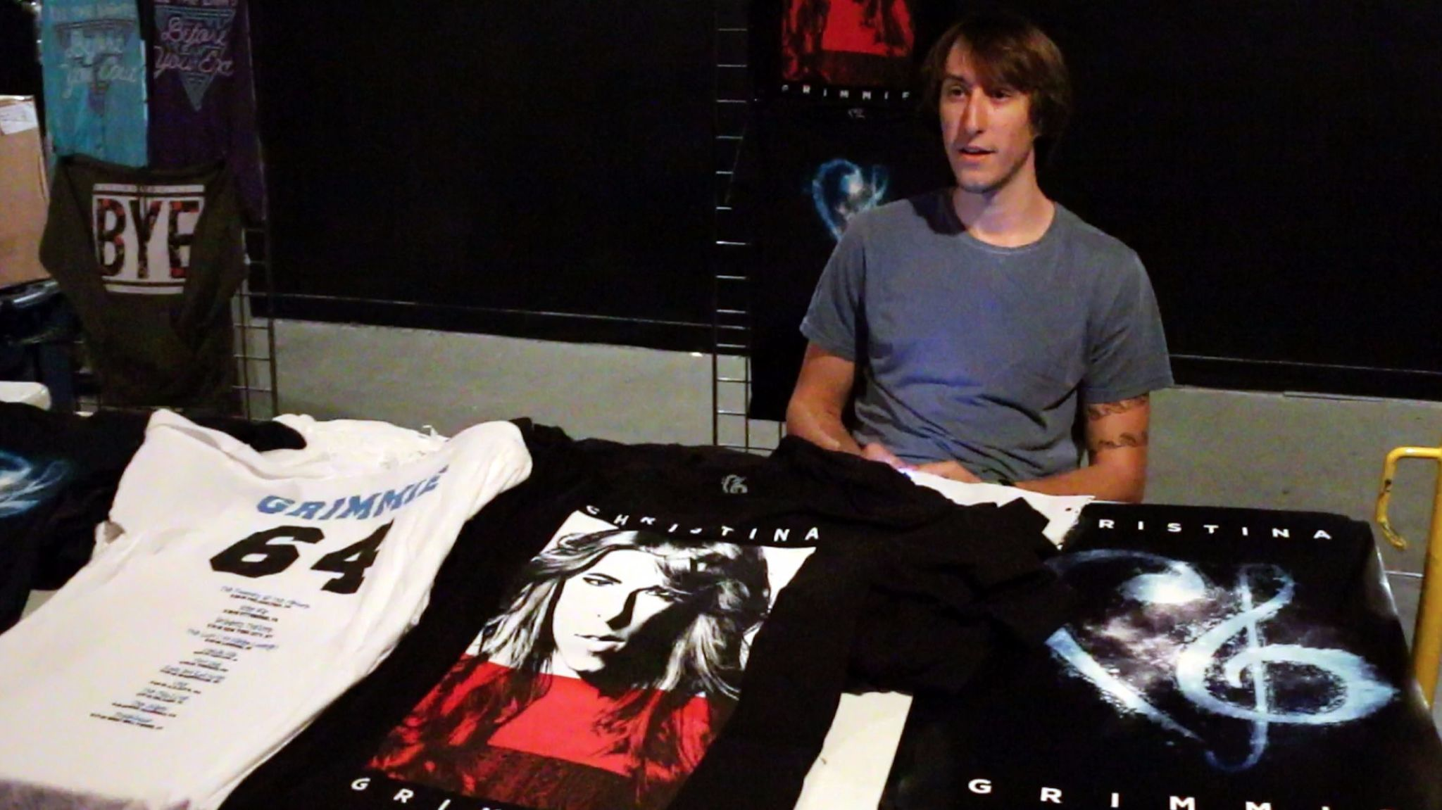 Mark Grimmie works the merchandise table at The Plaza Live on June 10.