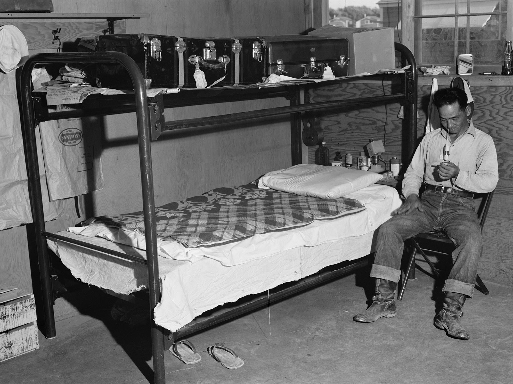 A 1942 photo of a barrack in the Twin Falls, Idaho, camp. Every barrack was divided into six apartments, each 14 feet by 16 feet. A typical apartment contained two pairs of bunk beds and a table with chairs.