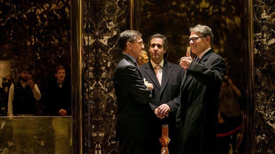 Michael Flynn, left, the retired general chosen by President-elect Donald Trump for national security adviser, speaks to Michael Cohen, center, an attorney for the president-elect, and Rick Perry, t