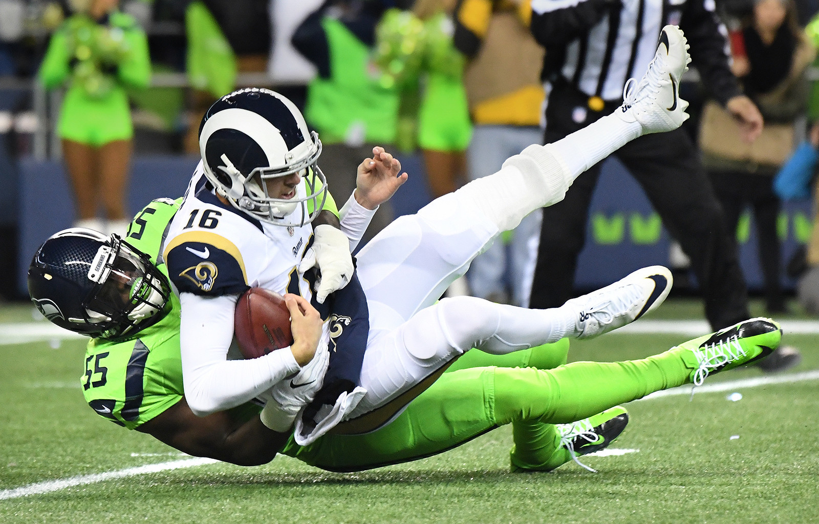 Rams quarterback Jared Goff is sacked by Seahawks defensive end Frank Clark during the first quarter of a game at CenturyLink Field on Dec. 15. (Wally Skalij / Los Angeles Times)