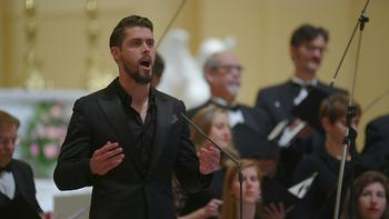 Justin Tucker sings at the Basilica