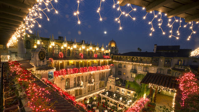 a view into the hotel courtyard during the festival of lights on the grounds of the
