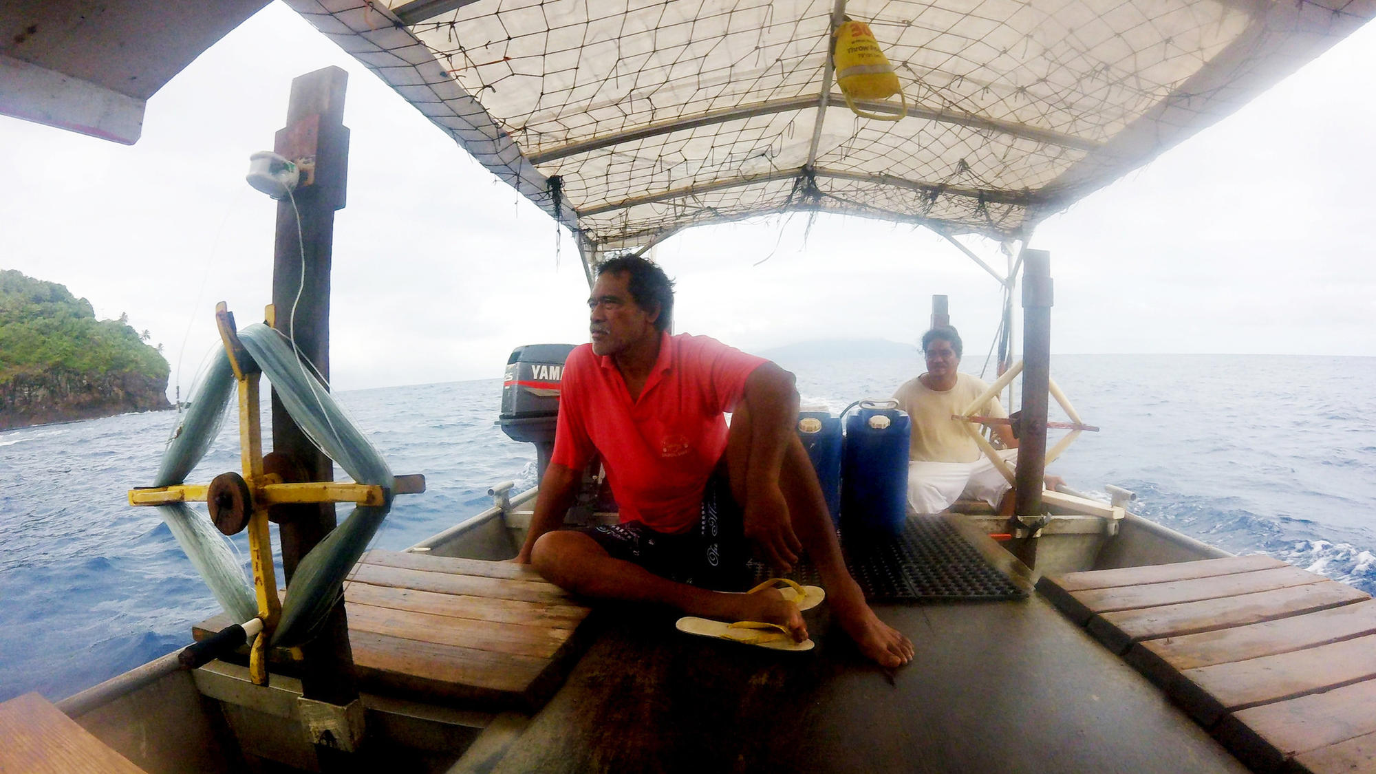 Fishermen Sam Vaa, in red, and Liu Sai sometimes carry passengers between the American Samoa islands of Ofu and Tau. There are no flights between the islands.