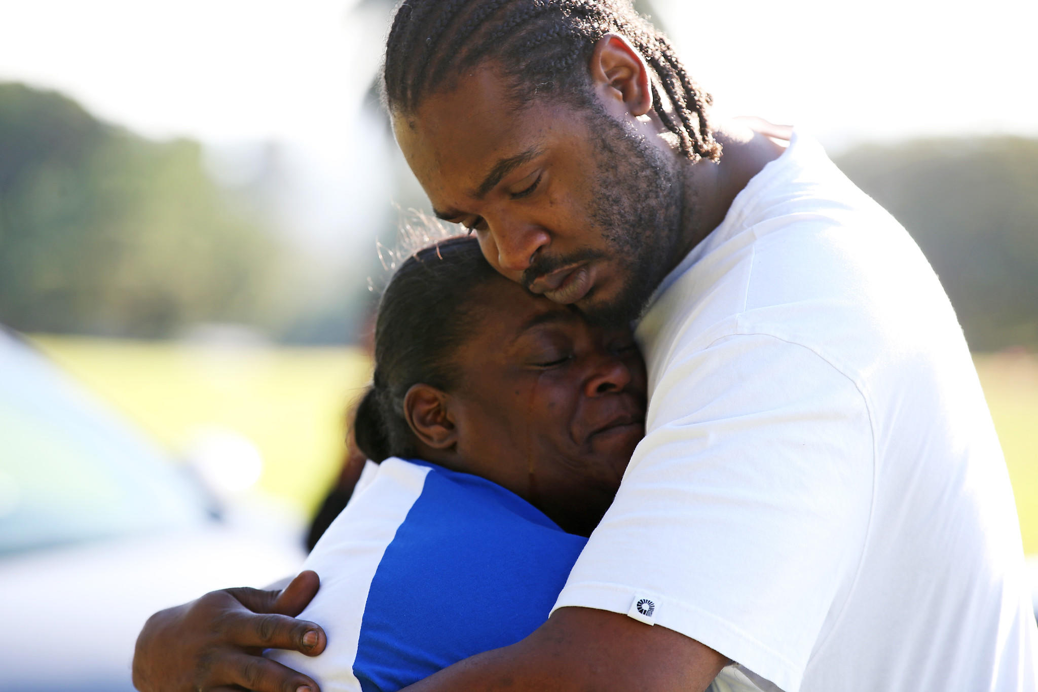 Barbara Pritchett-Hughes comforted by her son DJ Harris