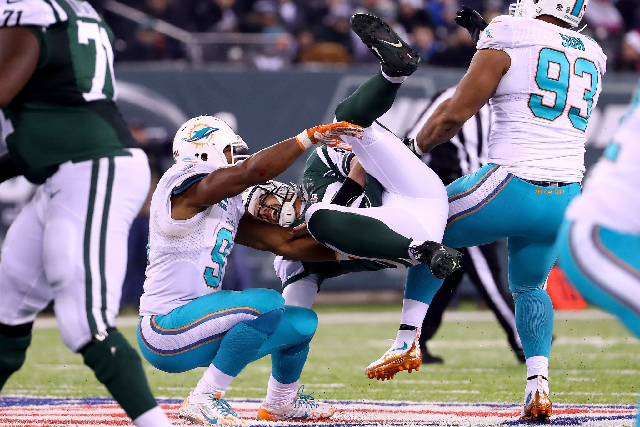 Dolphins defensive linemen Cameron Wake and Ndamukong Suh named to