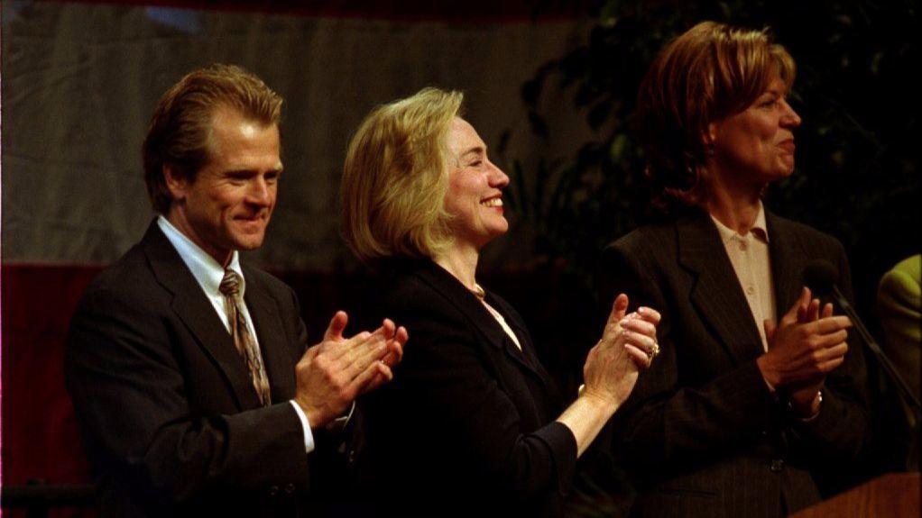 Nov. 2, 1996: Congressional candidate Peter Navarro and first lady Hillary Rodham Clinton shared the stage at a Navarro campaign rally at UCSD. Here, they were applauding introductory remarks by Rep. Bob Filner, D-San Diego.