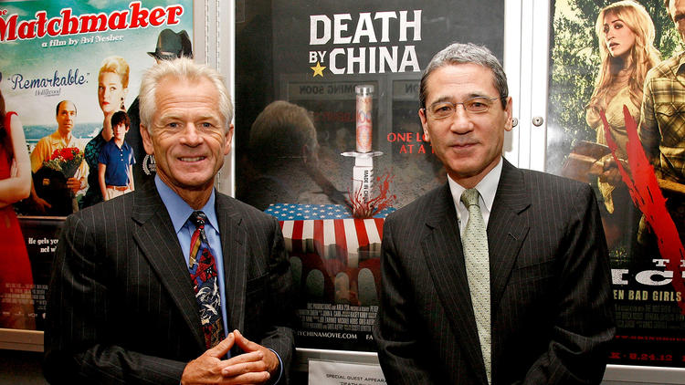 "Peter Navarro, left, and China expert Gordon Chang attend a screening of ""Death By China,"" the film adaptation of Navarro's book, in New York in 2012. (Andy Kropa / Getty Images)"