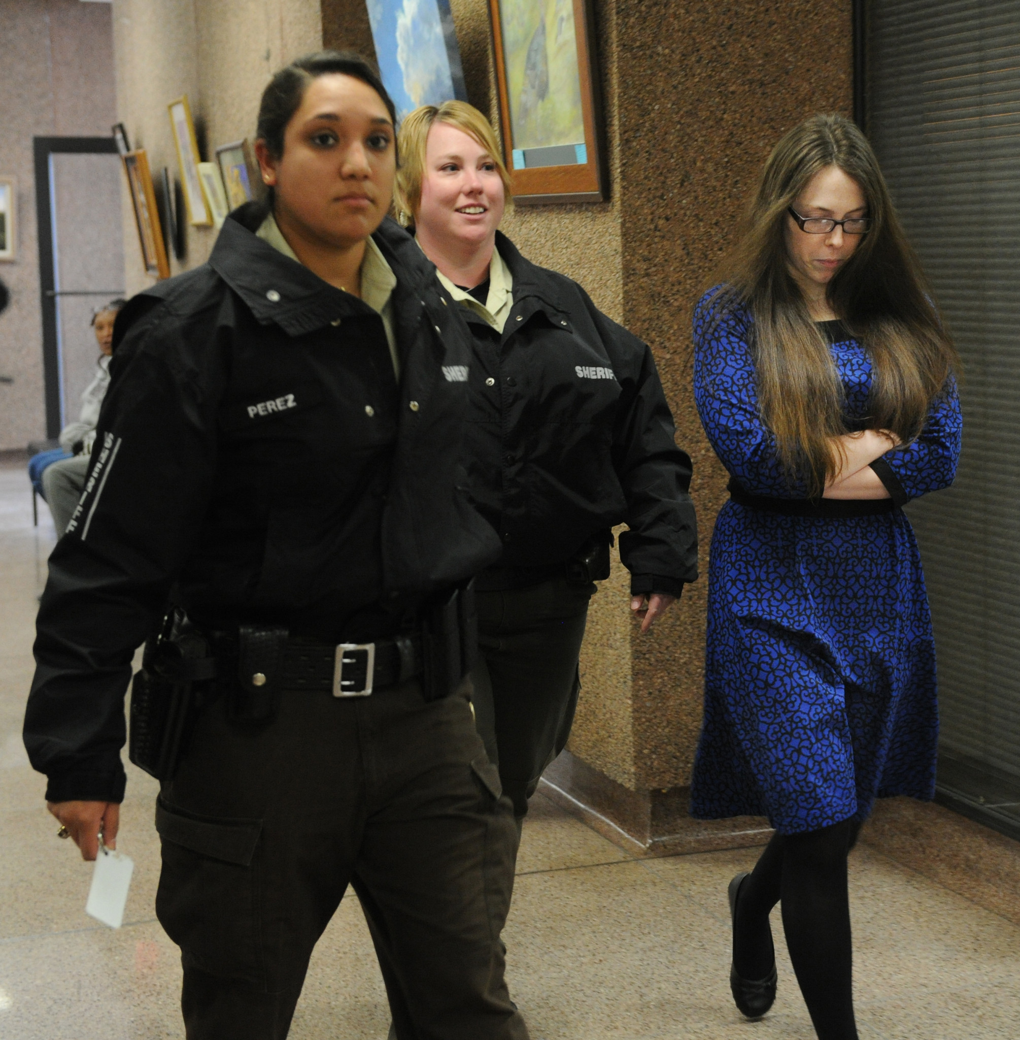 Tiffany Klapheke, right, at the Taylor County Courthouse in Abilene, Texas.