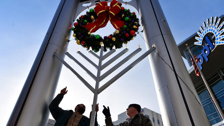 Raising the Menorah for Hanukkah